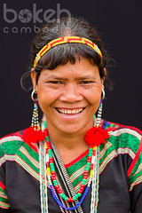 Portrait of a colorful Bunong minority woman | Mondulkiri Province, Cambodia (bokehcambodia) Tags: old portrait people woman black beautiful smile look smiling vertical closeup lady female person one community asia cambodge cambodia southeastasia pretty cambodian khmer village looking close head background gorgeous traditional group decoration culture jewelry highland burn attractive tribes backdrop farmer lovely charming tribe ethnic upclose minority northeast province cultural indigenous hilltribes villager northeastern hilltribe indochina minorities eldery kampuchea ethnographic mondulkiri pnong chunchiet portraitorientation verticalorientation ethnicgroup bunong mundulkiri shlash shlashandburn