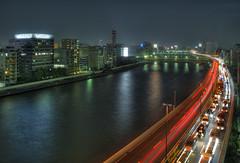 Tokyo 2927 (tokyoform) Tags: street city bridge urban reflection cars japan skyline architecture night buildings river dark 350d japanese tokyo calle asia cityscape skyscrapers traffic moto