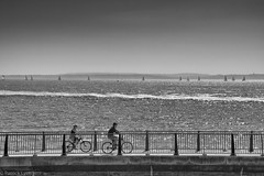 Cycling by the Sea (P H Lyen) Tags: ocean uk cruise sea summer england sky sun water bike fence silver cycling boat warm europe wake wind unitedkingdom solent portsmouth sail bliss
