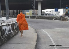 Buddhist monk collecting alms in the city (Rich Friend) Tags: street city urban orange colour thailand asia bangkok citylife streetphotography documentary streetlife buddhism everyday siam everydaylife saffron socialdocumentary alms urbanlife urbanspace cityspace urbanasia collectingalms bangkokstreet therevada phrakhanong