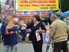 'dog on the street' interview (Robert S. Photography) Tags: camera summer food dog signs colour television brooklyn iso100 casio microphone brightonbeach owner 2012 streetfestival interviewed exzs5