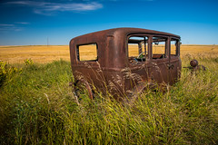 A Single Word (Wayne Stadler Photography) Tags: auto old canada cars abandoned field car rural vintage countryside rust village antique decay teal wheat ghost rusty machinery chrome vehicle ghosttown weathered remote homestead aged saskatchewan prairies derelict remains wrecked automobiles neidpath prairiesautomobile