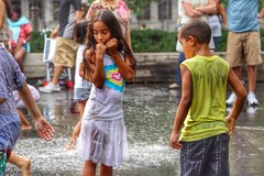 young love. (alyssaBLACK.) Tags: city boy summer people urban usa chicago color colour water fountain colors girl kids america canon children us illinois colorful colours vibrant candid streetphotography colourful crownfountain hdr splashing canoneos70d