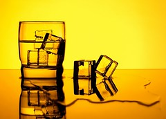 Ice Cubes (Karen_Chappell) Tags: ice glass orange yellow water liquid icecubes stilllife reflection square black