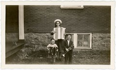 Accordion Kids (Alan Mays) Tags: ephemera photographs photos foundphotos snapshots portraits children boys girls clothes clothing suits dresses hats smiles smiling happy morose unhappy music musicians musicalinstruments accordions accordionists accordionplayers trumpets toys cannons buildings porches bricks windows serrated edges borders antique old vintage