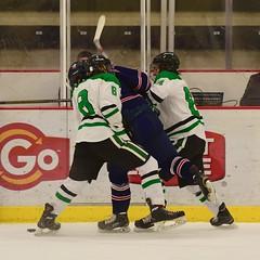 sandwich... (R.A. Killmer) Tags: hockey ice skate sru puck shot acha green white