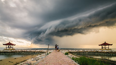 Thunderstorm Approaching (eggysayoga) Tags: bali panorama cloud dog storm clouds sunrise walking indonesia landscape nikon tokina thunderstorm thunder pantai balai sanur karang 1116mm d7000 sekepat