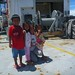 <p>Grace Sabadoquia with children Dean Juanito, Abigail Juanito, and Katrina Juanito on the R/V Revelle deck.</p>