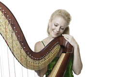 Smiling woman with harp (Elvin Cheng) Tags: portrait musician music beauty smiling horizontal standing photography happiness indoors whitebackground studioshot harp musicalinstrument done blondehair eyesclosed adultsonly oneperson 40s frontview skill caucasian stringedinstrument midadult colorimage onewomanonly waistup classicalmusician artscultureandentertainment onemidadultwomanonly