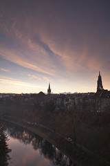 Red clouds are reflected in water - Bern (Sinar84 - www.captures.ch) Tags: city morning blue winter red brown white black green church yellow clouds sunrise reflections river landscape schweiz switzerland swiss gray before bern oldtown aare swissalps ref swissmountains munster