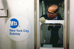 All Aboard (ep_jhu) Tags: nyc newyork man window train out subway fuji looking unitedstates bald mta fujifilm gothamist operator hombre conductor peering x100s