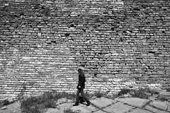 The wall (Daniel Nebreda Lucea) Tags: wall black white blanco negro stone piedra texture textura old vieja antiguo woman mujer girl chica walking andando andar walk shadows sombras lights luces travel viajar city ciudad street calle nature naturaleza urban urbano aragon boltaña spain españa europe europa canon 60d architecture arquitectura structure estructura composition composicion monochrome monocromatico pared castle castillo background fondo bw