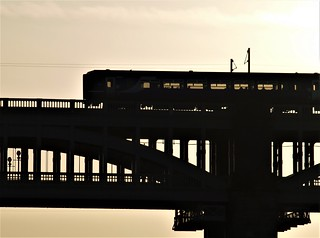 Silhouetted 142 Pacer Passenger Train Crossing High Level Bridge - Newcastle