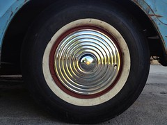 Pond Ripple (misterbigidea) Tags: street blue red urban abstract reflection car wheel circle mirror shiny view ripple rusty tire explore part chrome eyeball redeye rim effect hubcap concentric whitewall fragment lookingatyou
