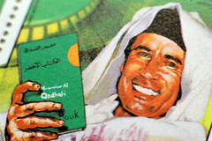 Muammar Gaddafi on a Stamp (Benn Gunn Baker) Tags: macro green canon book eyes baker political tube evil theory stamp revolution third universal extension popular benn gunn ideology the gaddafi qadhafi 550d t2i fractalius