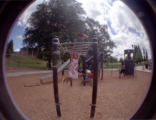 Niece on the monkey bars.