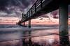 rusty morning ... (StillBelieven) Tags: bridge light sea beach nature clouds sunrise landscape nikon 18105mm seasunclouds nikon18105mm absolutegoldenmasterpiece d5100