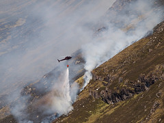 04_05_2011_0405 (andysuttonphotography) Tags: wild mountain water fire scotland highlands heather smoke flames scottish dry aerial smoking helicopter burning burnt cul blaze wilderness firefighting mor wildfire heatwave extinguish extinguishing blackened assynt drenching dousing