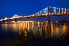 SF_021614_0305 (Andygt) Tags: sanfrancisco bridge blue sky reflections lights bay piles