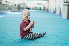 Amelia Cheesing in the Airport (donnierayjones) Tags: baby girl bar airport toddler eat snack cracker