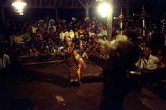 26-397 (ndpa / s. lundeen, archivist) Tags: flowers people bali color film girl musicians kids 35mm dark children indonesia dance costume clothing child dancing audience 26 stage traditional nick performance culture dancer southpacific 1970s spectators 1972 youngwoman indonesian gamelan underexposed headdress onlookers balinese dewolf oceania pacificislands nickdewolf photographbynickdewolf metallophones pacificislandculture reel26