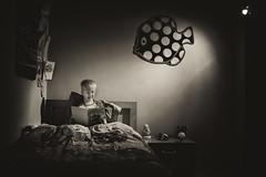 Bedtime Stories (Gikon) Tags: light bw monochrome night reading book evening nikon shadows child bedtimestories bedtime 1855mm abigfave gikon d3100