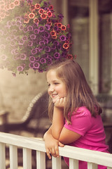 (Rebecca812) Tags: pink flowers portrait people cute girl smile happy kid child sweet candid longhair happiness railing frontporch idyllic leaning hangingbasket chidlhood restinghead reallifemoment chinrestingonhand canon5dmarkii rebecca812