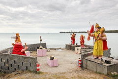 Mauritius - Hinduism on the shore (Romeodesign) Tags: ocean flowers sea beach island ganesha shrine day cloudy maurice indianocean statues ile altar holy shore tropical hanuman mauritius hindu hinduism sculptures mantra namah 550d shivaya anjaneya montchoisy omnamah