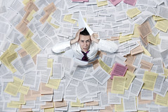 istock_000012979575medium (TSI Healthcare) Tags: man horizontal businessman paper chaos mail flood text file stack busy papers messy document depression archives data despair concept ideas information documents oneperson headache overflow 20s paperwork caucasian shirtandtie emotionalstress