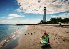 a place in the sun (Sky Noir) Tags: travel people lighthouse beach sunshine birds palms day unitedstates chairs florida cloudy palmtrees shore seashore keybiscayne capeflorida skynoir
