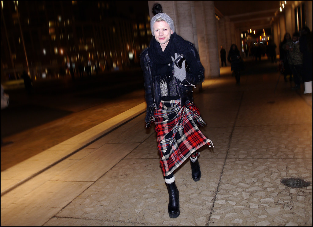 FW 2014-2 -10 Blond male model black leather jacket tartan wrap skirt black scarf black flat platform ankle boots ol