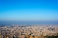 Untitled (Samarth Ghiya) Tags: city morning travel blue houses sky urban india buildings photography smog nikon cityscape atmosphere jaipur nahargarh d5200
