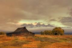 Mormon Barn On a Cloudy Sunrise (diana_robinson) Tags: sunrise jackson wyoming grandtetons lowclouds grandtetonnationalpark mormonbarn cloudysunrise nikond3s autumninthetetons