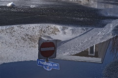 through the looking glass (heatherybee) Tags: road street house snow signs window water sign reflections puddle march pavement bluesky streetsigns winterspring snowmound