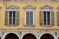 Giallo Parma a Reggio (Parma yellow in Reggio) (S. Hemiolia) Tags: windows muro window yellow wall finestra giallo palazzo azzurro lightblue muri reggioemilia palazzi finestre persiane intonaco viaemilia gialloparma