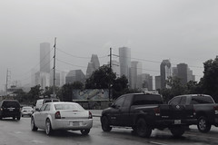 (eflon) Tags: road cars skyline highway texas tx houston rainy i10 lowsaturation bldgs monochromeish