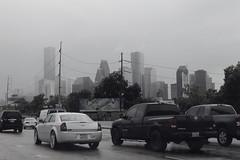 (eflon) Tags: road cars skyline highway texas tx houston rainy i10 lowsaturation bldgs monochromeish