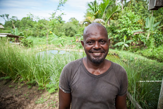 Marcus Rongodala stands in front of his tilapia pond, Rafrafu, Central Kwaraiae, Malaita Province, Solomon Islands. Photo by Filip Milovac.
