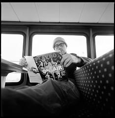 Sunday noon reading (Istvan Penzes) Tags: bw white black handheld manualfocus fujineopan400 kodaktmaxdeveloper homedeveloped hasselbladswc aphog sekonicl308s penzes imaconflextight343 carlzeissbiogon4538