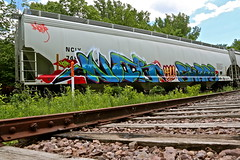 Shape//Noir.  AU. (Urban Camper.) Tags: blue sky tree art grass minnesota st train paul graffiti paint track noir au low profile cities minneapolis twin line u aerosol shape hopper aerosolart shape2 shaper alwaysup