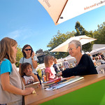Jacqueline Wilson signs books for young readers at the 2003 Edinburgh International Book Festival