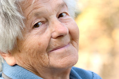 Elderly woman smiles (Netlivre) Tags: old portrait people woman senior smile face look smiling horizontal female hair outdoors person grey nice healthy eyes adult grandmother expression dream adorable poland headshot nostalgia health mature elderly wise friendly aged wisdom cheerful aging citizen wrinkles healthcare daydream retirement pension intelligent wrinkled caucasian eighty pensioner retire ninety