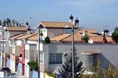 Chalets (townhouses) in suburban Granada. Note the Spanish tile roofs but otherwise boxy style.
