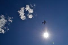 Sunshine Lens Flare (Nicki Ki) Tags: travel summer sky sun sunshine clouds contrast airplane flying warmth lensflare