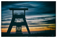 Withering Glory (chmeermann | www.chm-photography.com) Tags: sunset silhouette clouds vintage aperture nikon sonnenuntergang mining nikkor frderturm ruhrgebiet ruhrarea herten bergbau 18135 shafttower landscapeformat d7100 vision:beach=0791 vision:sky=0965 vision:outdoor=0903 vision:clouds=0784 vision:ocean=078 analogefexpro