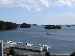 IMG_2166 (jaglazier) Tags: trees japan clouds boats islands march landscapes seascapes transport motorboats matsushima miyagi forests miyagiken 2014 matsushimabay 31514 coniferoustrees miyagidistrict copyright2014jamesaglazier matsushimacenturyhotel