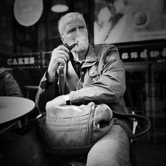 Pipe dreams (Rob Pearson-Wright) Tags: street uk blackandwhite bw man london relax sitting candid smoke pipe streetphotography streetlife iphone uploaded:by=flickrmobile flickriosapp:filter=nofilter