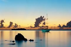 Ghost Ship (bac1967) Tags: sea slr film sailboat 35mm island islands boat long exposure kodak olympus sail 100 135 northern commonwealth om1 mariana saipan phillipine marianas ektar managaha cnmi
