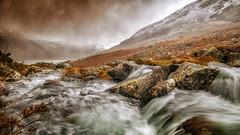Wild waters (Einir Wyn Leigh) Tags: landscape water rugged mountains weather climate rain outdoors river snowdonia wales gold natur natural snow beauty clouds storm winter
