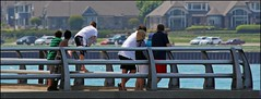 St. Clair River (Sue90ca On The Mend: Trying To Catch Up) Tags: bridge people cars swim canon divers flags frombehind skate 60d